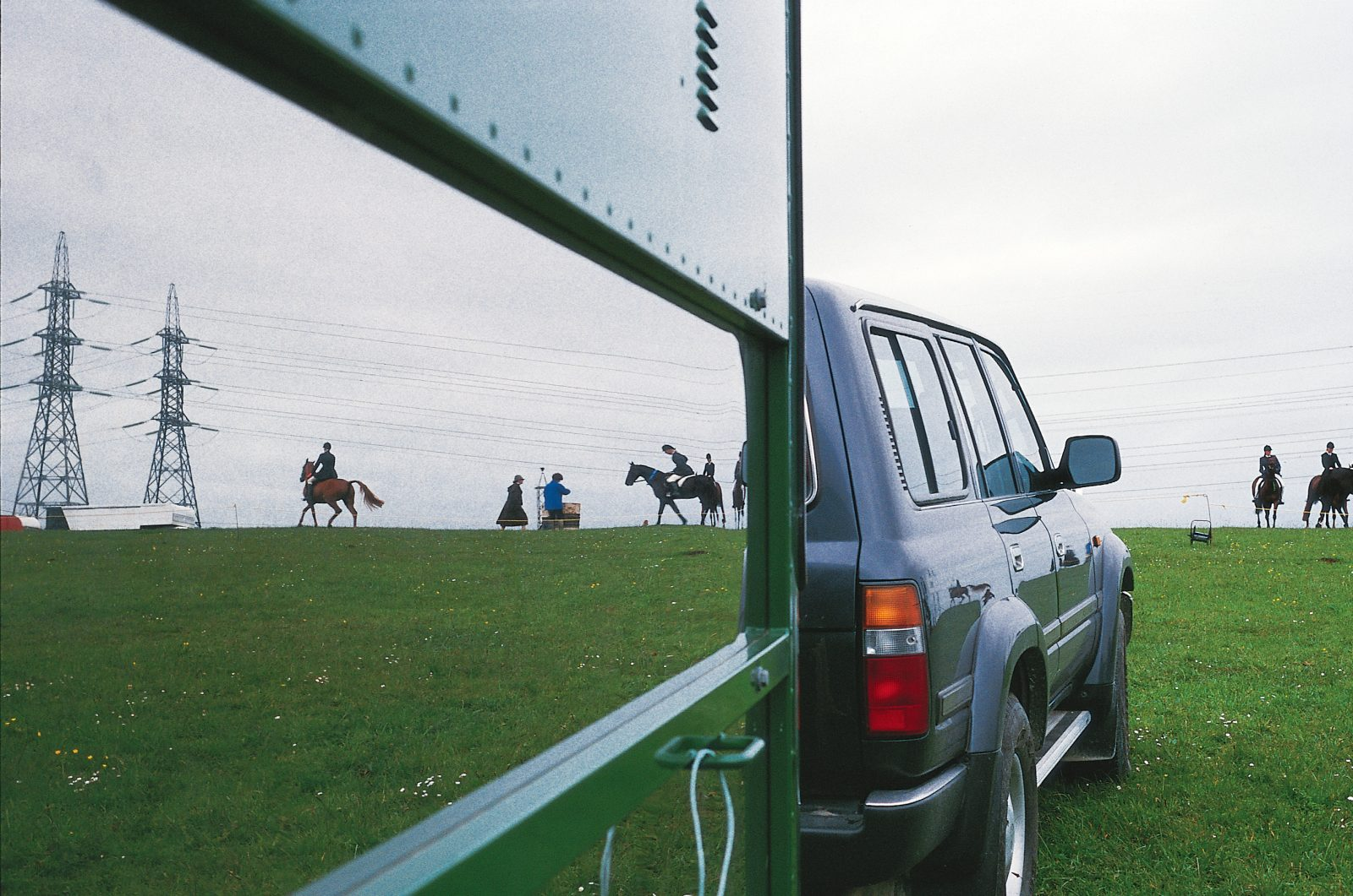 The last riders leave the ground on the final ribbon day held at the Albany Pony Club's Bass Road grounds, October 1996, before the machines move in. Like riverboats, kauri trees, gumdiggers and orchards, horses are a reflection of a rural Albany now past, as the area looks forward to a new incarnation as a focus of Auckland's growth.