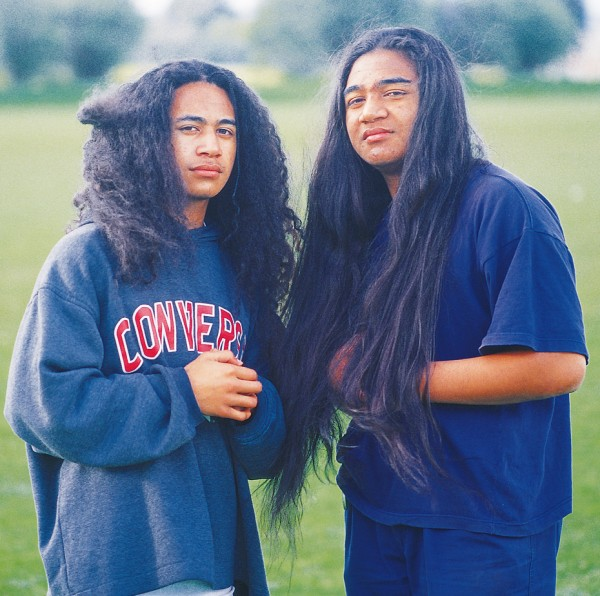 Niuean island culture is preserved far from home. Auckland teenagers Tagamaka and Alfie Talagi are about to lose their long hair at the traditional boys' hair-cutting ceremony. Their flowing locks, lovingly cared for through childhood by sisters, mother and aunts, have only ever been trimmed. At the ceremony, the women of the family will tend the hair for the last time before cutting it short.