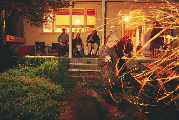 The bright lights and driving rhythms of Colville nightlife are strictly do-it-yourself. At Moehau Community, Bronwyn Matheson performs a kerosene lantern fire dance to a jazzy accompaniment from the back porch.