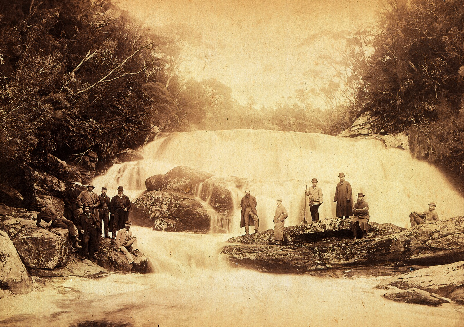 Todd (third from right), an Invercargill businessman, bought 50 acres of land here, including the waterfall, from a gold prospector. Although the original samples of cassiterite (tin oxied) were collected in Pegasus Creek, just above the falls, subsequently yields were disappointing. Best approached from the water, Belltopper Falls are today a popular destination for sea kayakers paddling Port Pegasus' enclosed waters.