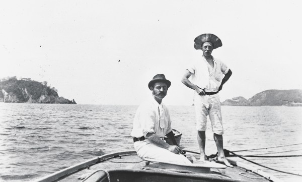 New Zealand's greatest maritime photographer, Henry Winkelmann (on the right), cruised the Hauraki Gulf on yachts, treamers and his own Logan Bros launch, Tawaki. Advances in photographic technology allowing fast exposures enabled him to click his shutter on heaving decks and up swaying masts. FOr more than three decades he captured the poetry of yachts under sail, his photographs surviving as one of the most complete records of the early days of sailing anywhere in the world.