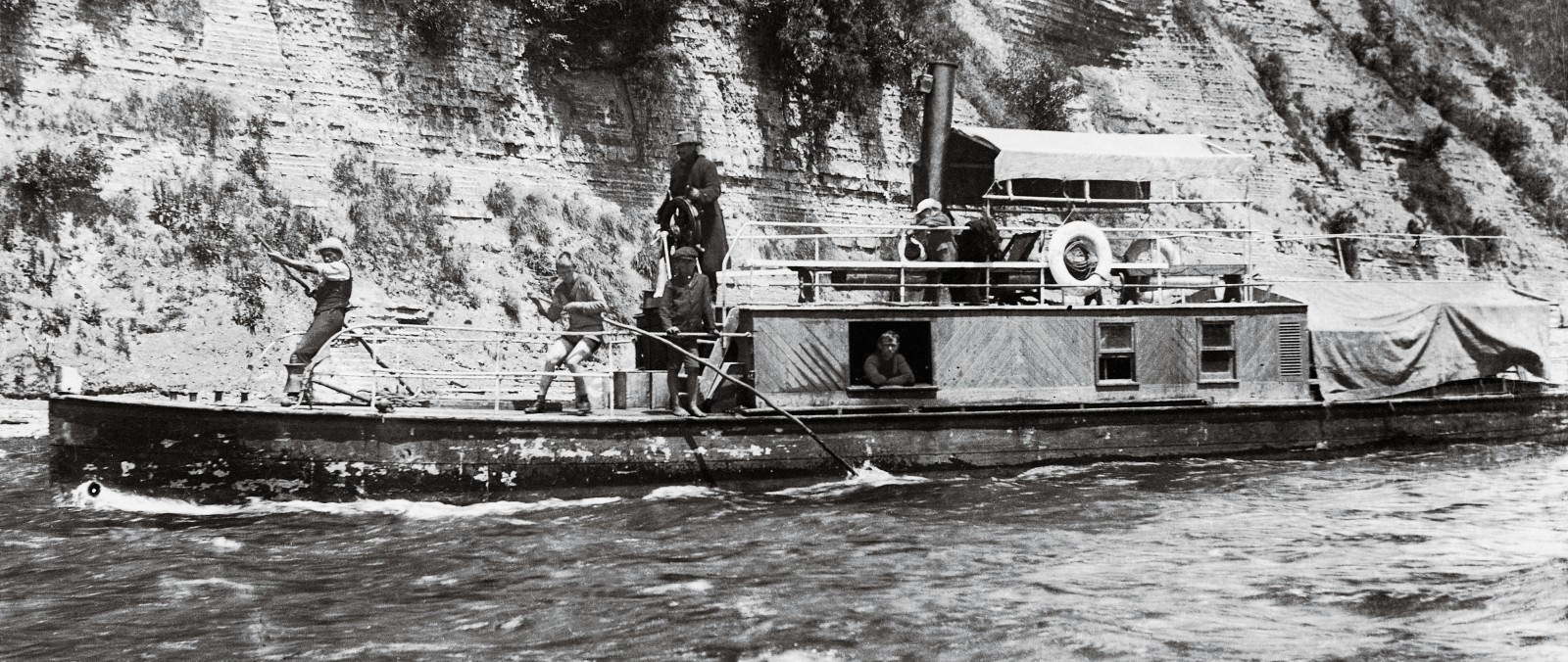 Backs and poles bending to the strain, the crew of Ongarue negotiate the Rurumaiakatea Rapid, a kilometre downriver from Taumarunui. Ongarue's shallow draught and tunnel screw made this trusty work horse ideal for the white-water reaches of the upper Whanganui, where she was held in considerable affection by settlers.