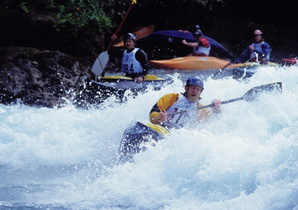 "High-ranking US competitor Rusty Sage (top) buries the nose of his kayak as he performs a ""blunt."" In the open canoe event (below), competitors use single paddles and kneel in their craft."