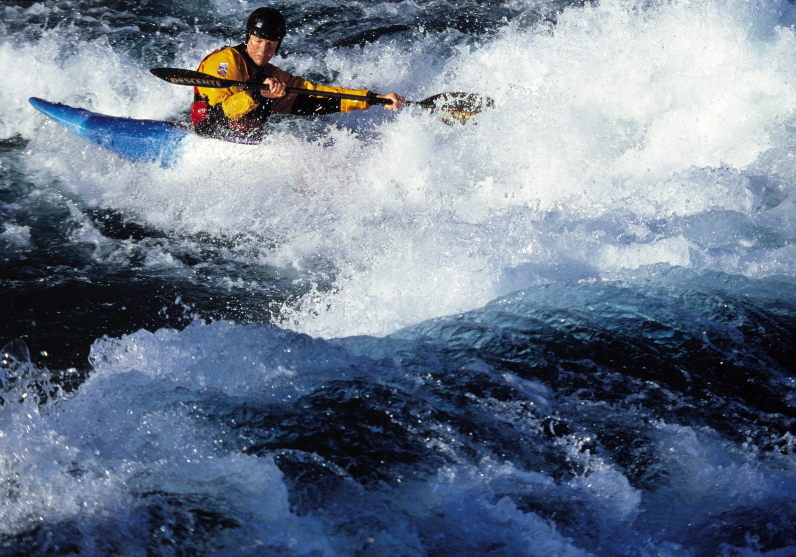 Drifting up on the crest, Turangi paddler Mike Birch studies the flexing wave, looking for a feature he can work with.