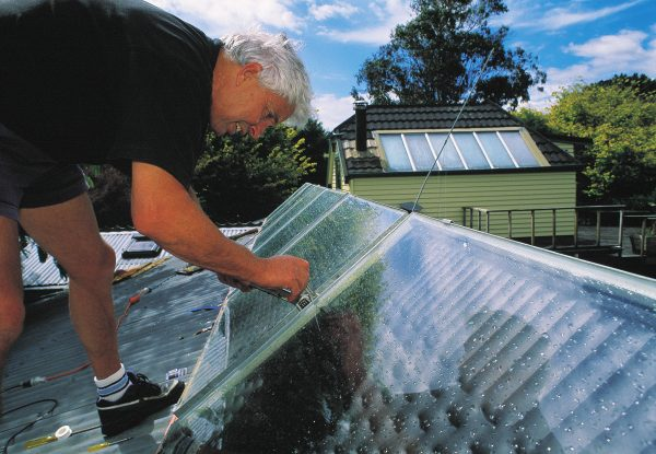 Ralph Sims, a professor at Massey University and a longstanding advocate of renewable energy-here installing a solar hot-water system on his housesays New Zealand could become the first country in the world to have 100 per cent renewable energy. High wind speeds, increasing volumes of forest residues, strong wave action, good solar radiation levels, abundant potential for small hydro schemes, fertile soils and a good climate for growing energy crops all make it a feasible proposition.