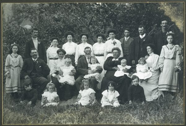From rags and imprisonment to a life of prosperity in the colonies—the Guard family, photographed here around 1910, still occupy original land holdings in the Marlborough Sounds.