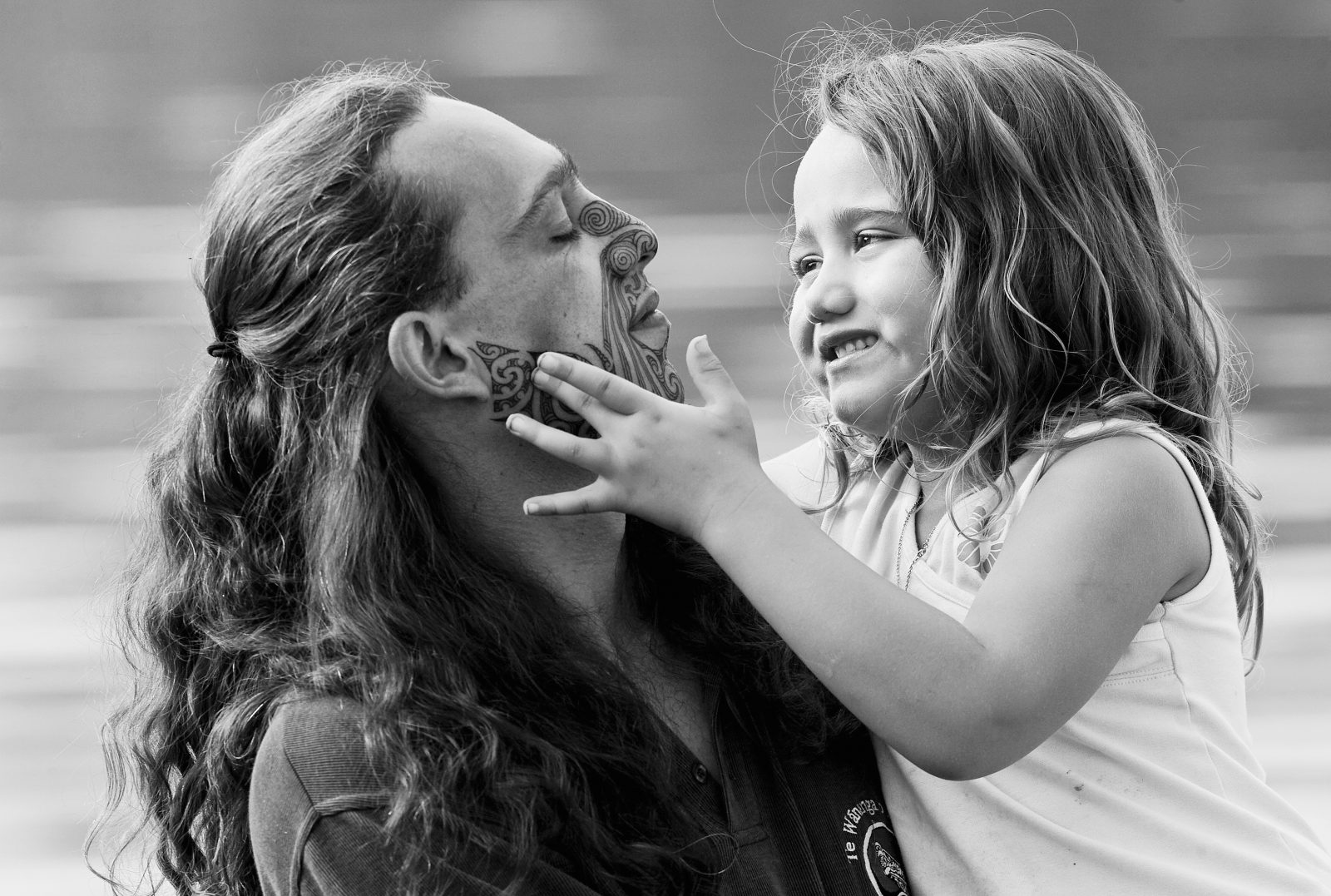 """""""Both Parina and Muriwai will put their fingers to my face, follow the lines and ask questions about what each line means. Muriwai was a bit concerned when she knew I was getting my moko done—she asked me if I will still be her father. I told her 'regardless of what Daddy does to his face, I will always be your father'. I think she thought that I would change as a person as well. I had to keep reassuring her that I'll be still her father, nothing's changed except my appearance."""" —Hohepa Hei"""