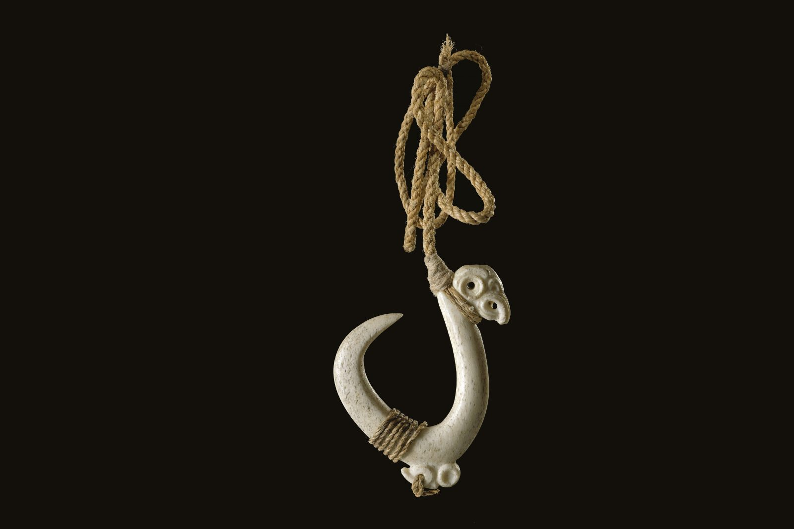 Traditional Maori hooks, or matau, functioned by rotating and trapping the jaw of the fish rather than by penetrating it in the manner of modern steel hooks. Fishing lines were attached to the hook with a short snood tied to a groove on the shank of the matau. This groove was at right angles to the direction of the point and caused the hook to rotate away from the direction of the point when under tension, trapping the fish's jawbone inside the narrow gap. Because matau did not function by piercing the fish, rods were not required to provide leverage to set the hook, and the hooks did not require a reversed barb. (80 mm length)