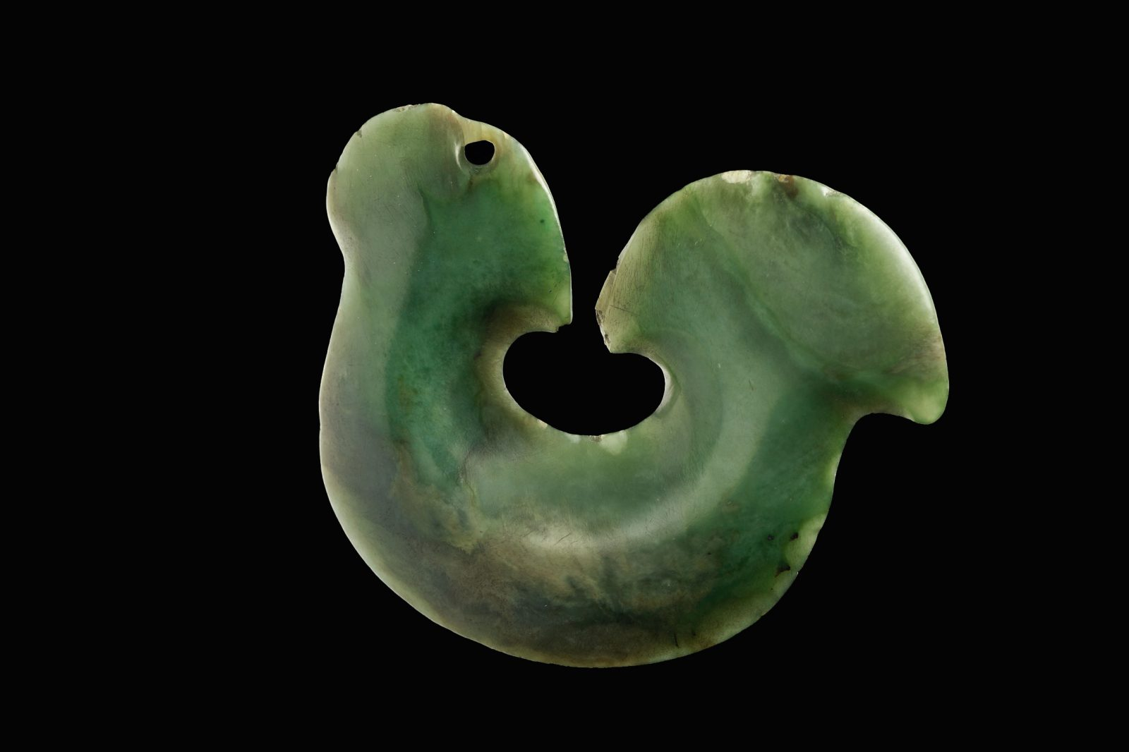 The wearing of stylised hei matau is today seen as a symbol of Maori cultural revival. Large, flat taonga which superficially resemble much smaller fishhooks were thought to be stylised fishhooks by early historians. However, they may in fact represent tools (possibly scrapers), which were replaced by metal tools shortly after the arrival of Europeans and retained as decorative items when the knowledge of their original function had been lost. (103 mm width)