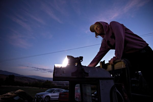 Emily Irwin tests the spotlight attached to the top of her father's Land Rover. The most successful bunny hunting teams shoot from dusk until dawn: night usually brings a greater yield of rabbits than day, with bunnies more likely to freeze on the spot than run. Shotguns are the weapon of choice (above).