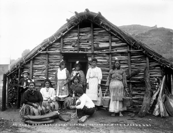 William Collis, the photographer who took most of the pictures featured in this story, visited Parihaka repeatedly to present the human face of the community—not just its political significance. Raised a Wesleyan, he had a strong belief in justice and the kinship of all races. He often photographed children and women, including this group preparing food outside a kāuta (cooking house) around 1900.