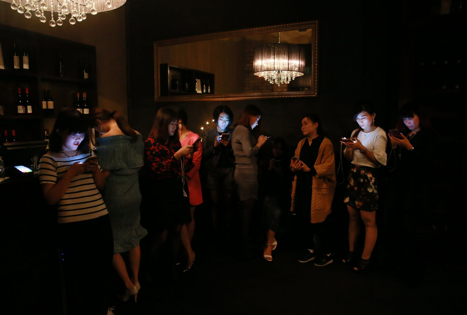 At an event in promotion of a line of skincare, Waikato Times photojournalist Mark Taylor noticed that many of the 30 guests were on their phones as they waited to be seated. Adjusting his exposure, he captured the light of each woman's smartphone screen illuminating her face.